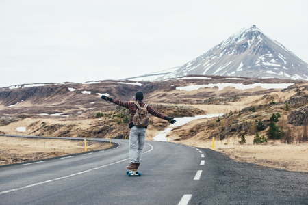 Skater traveling iceland on his longboard