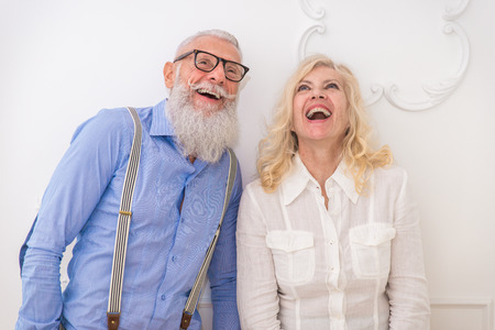 Senior couple in the 60s having fun at home - Cheerful married couple portrait, concepts about seniority and relationship Stock Photo