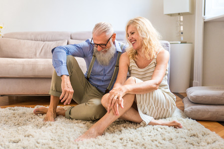 Senior couple in the 60's having fun at home - Cheerful married couple portrait, concepts about seniority and relationship Stock fotó