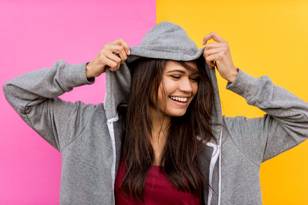 Portrait of stylish pretty girl on colored background - Happy woman with urban styled attire, concepts about lifestyle and youth