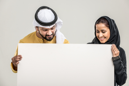 Portrait of arabic couple with traditional clothes in a studio