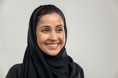 Portrait of arabic woman with traditional abaya dress in a studio