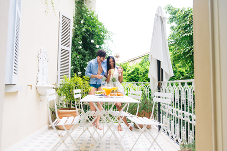 Happy couple having healthy breakfast at home in the morning - Happy moments of domestic partnership Standard-Bild - 109013056