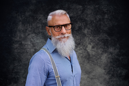 Handsome senior man portrait - Youthful and stylish man in the sixties, concepts about lifestyle, seniors and business