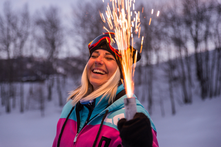 Happy girl having fun on winter vacation - Young woman with snow suit partying outdoors Imagens