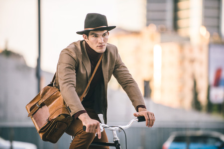 Young handsome man with casual clothes driving bycicle - Young student portrait, concepts about business, mobility and lifestyle Stock fotó - 109904297
