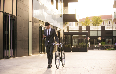 Young handsome man with business suit driving bycicle - Corporate businessman portrait, concepts about business, mobility and lifestyle Stock fotó - 109901356