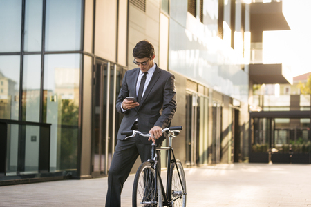 Young handsome man with business suit driving bycicle - Corporate businessman portrait, concepts about business, mobility and lifestyle Stock fotó - 109901358