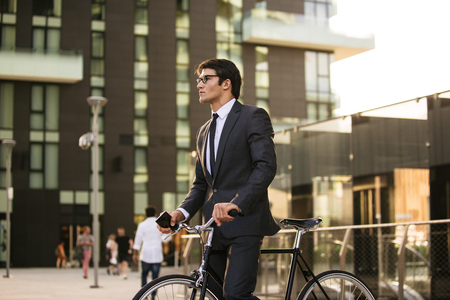 Young handsome man with business suit driving bycicle - Corporate businessman portrait, concepts about business, mobility and lifestyle Stock fotó - 109901439
