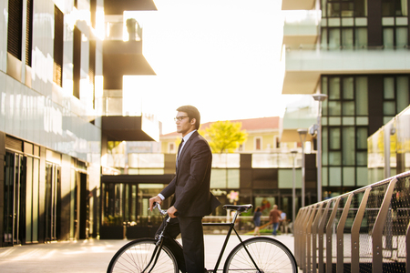 Young handsome man with business suit driving bycicle - Corporate businessman portrait, concepts about business, mobility and lifestyle Stock fotó - 109901442