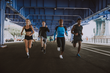 Group of urban runners running on the street in New york city, conceptual series about sport and fitness