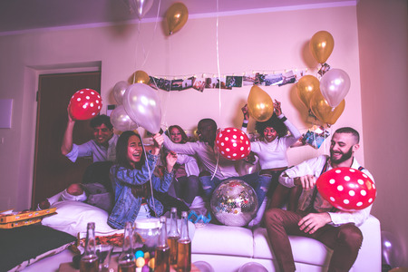 A group of young people celebrating and making party at home Standard-Bild - 111587884