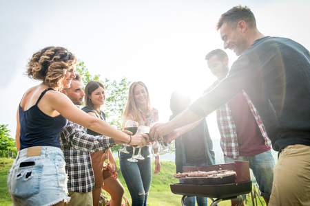 Group of young happy friends having fun outdoors Stock Photo