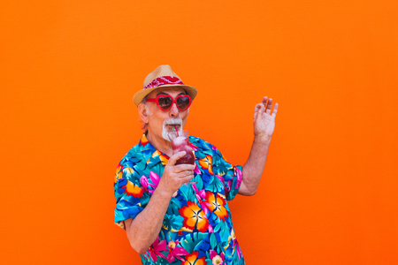 Funny and extravagant senior man posing on colored background - Youthful old man in the sixties having fun and partying 스톡 콘텐츠 - 111586953