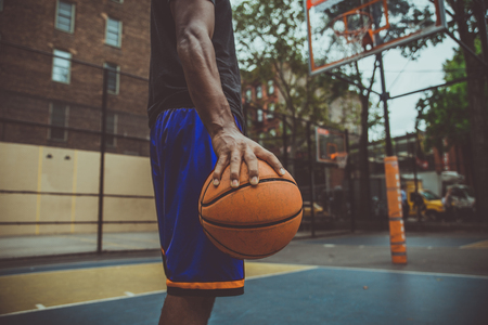 Basketball player training on a court in New york city 스톡 콘텐츠 - 111481724