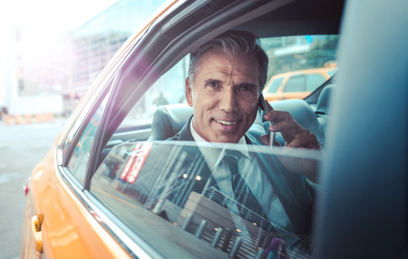 Successful business man in New york city, portraits and lifestyle. businessman sitting in a cab Stock Photo