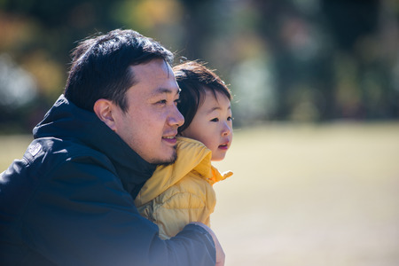 Happy and playful japanese family in a park in Tokyo Stock Photo