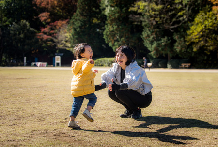 Happy and playful japanese family in a park in Tokyo