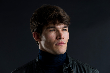 Portrait of young handsome man in a photographic studio