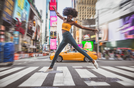 Young beautiful girl walking in Time square, manhattan. Lifestyle concepts about New york Stock Photo