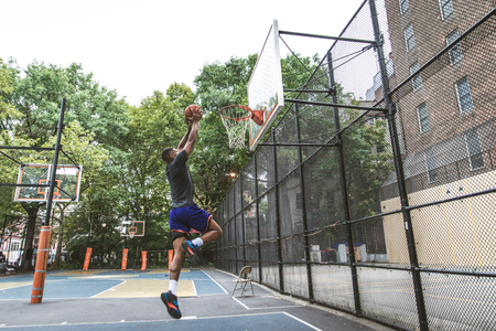Afro-american basketball player training on a court in New York - Sportive man playing basket outdoors Stok Fotoğraf