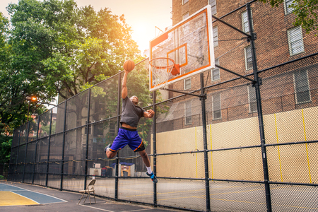 Afro-american basketball player training on a court in New York - Sportive man playing basket outdoors Stock fotó