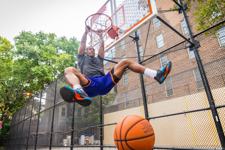 Afro-american basketball player training on a court in New York - Sportive man playing basket outdoors Reklamní fotografie