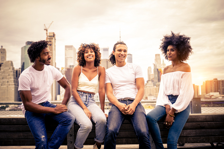 Group of afro american friends bonding in Manhattan, New York - Young adults having fun outdoors, concepts about lifestyle and young adult generation