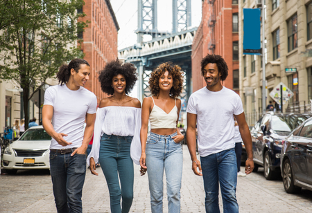 Group of afroamerican friends bonding in Manhattan, New York - Young adults having fun outdoors, concepts about lifestyle and young adult generation