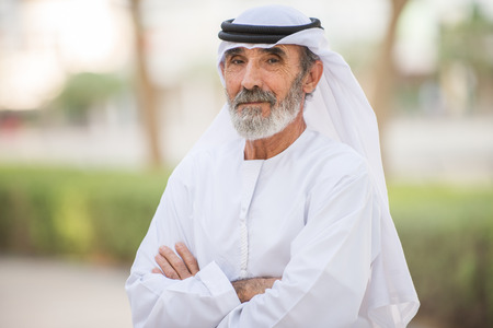 Arabian senior man with traditional white kandura portrait