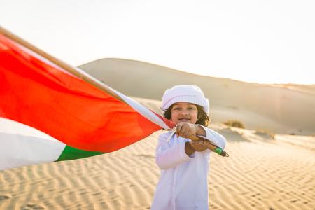 Arabian family with kids having fun in the desert - Parents and children celebrating holiday in the Dubai desert Banco de Imagens