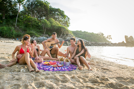 Group of happy friends on a tropical island having fun - Young adults playing together on the beach, summer vacation on a beautiful beach Reklamní fotografie