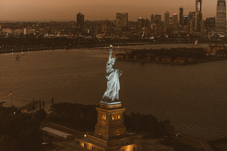 Statue of Liberty from above, New York - View of NY landmarks from helicopter tour Stock Photo