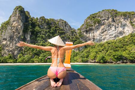 Beautiful woman on a long-tail boat in Phi Phi Island, Thailand - Young pretty girl on summer vacation in south-eastern asia