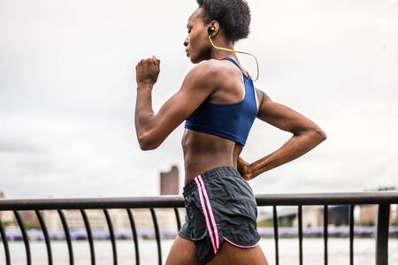 Young fitness woman running in New York - Sportive girl training outdoors, concepts about sport and healthy lifestyle