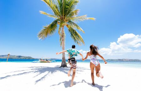 Couple spending time on a beutiful remote tropical island in the philippines. Concept about vacation and lifestyle.