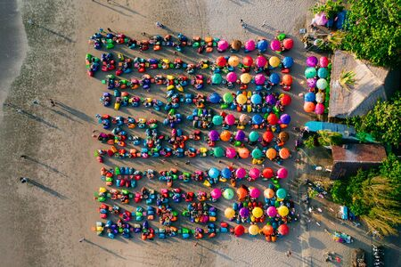 Aerial view of the beach with multicolored umbrellas and decks