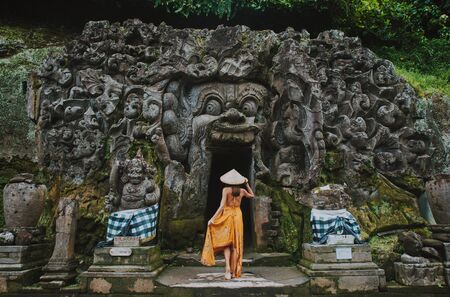Beautiful girl visiting the goa gajah temple in ubud , Bali. Concept about wanderlust traveling 스톡 콘텐츠