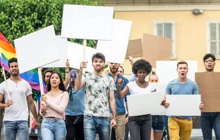 Public demonstration on the street against social problems and human rights. Group of multiethnic people making public protest Stok Fotoğraf - 126356347