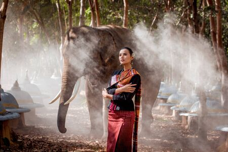 Elephant with beautiful girl in asian countryside, Thailand Stock fotó