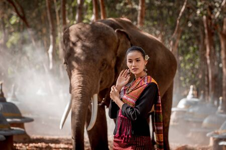 Elephant with beautiful girl in asian countryside, Thailand Reklamní fotografie