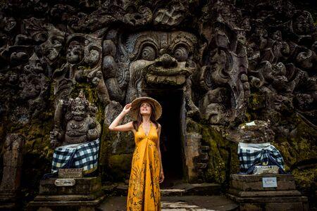 Beautiful woman in old hindu temple of Goa Gajah near Ubud on the island of Bali, Indonesia Stock fotó