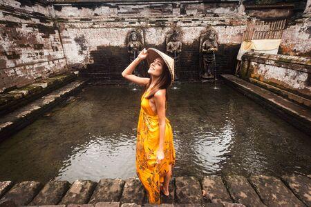 Beautiful woman in old hindu temple of Goa Gajah near Ubud on the island of Bali, Indonesia Stock Photo
