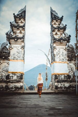 A woman at ancient gates in Pura Lempuyang