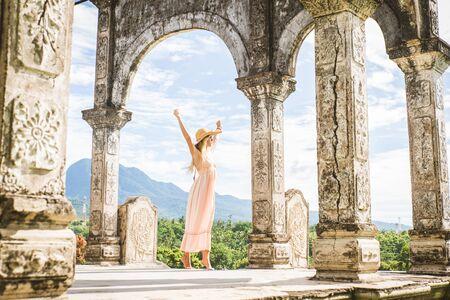Young beautiful woman in Taman Ujung water palace, Bali island, Indonesia