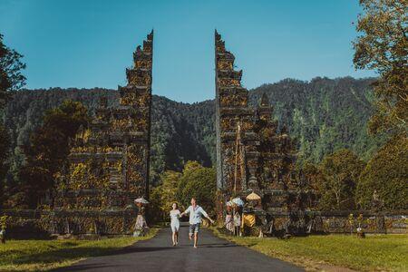 Couple of travelers at Handara Gate in Bali