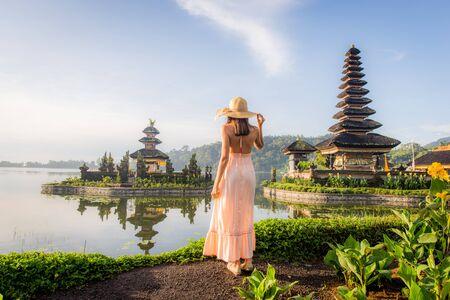 Young woman  at the Pura Ulun Danu Bratan, Bali.