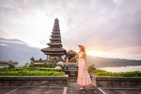 Young woman at the Pura Ulun Danu Bratan, Bali.