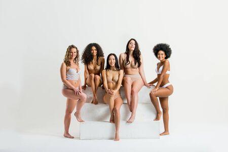 Multi-ethnic group of beautiful women posing in underwear in a beauty studio