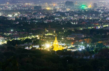 Sanda muni pagoda in Mandalay, at night time. View from the hills out the city